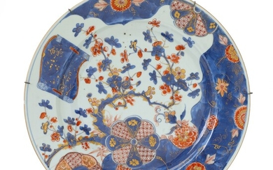 A Chinese Imari porcelain dish in underglaze blue, iron red, and gold with prunus in...