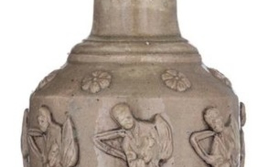 A Chinese celadon glazed stoneware vase, relief decorated...
