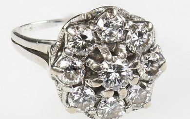 A DIAMOND CLUSTER RING, CIRCA 1975 The tiered cluster