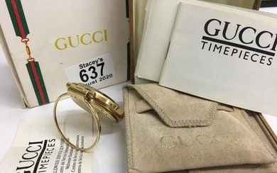 A Gucci Gold plated 0300 Bellissimo travel clock with origin...