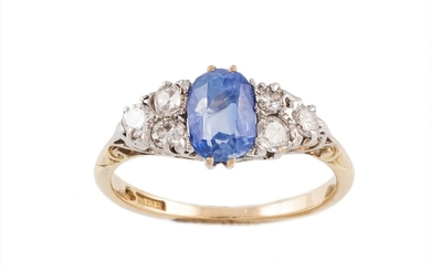 A LATE VICTORIAN SAPPHIRE AND DIAMOND CARVED HEAD RING, with...