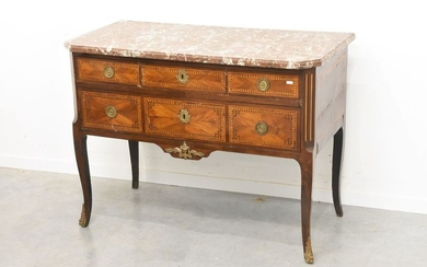 A Louis XVI period commode in marquetry, enhanced...