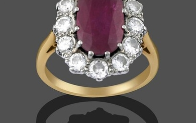 A Ruby and Diamond Cluster Ring, the central oval cut...