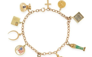 A VINTAGE CHARM BRACELET in 14ct and 9ct yellow gold