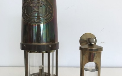 A brass oil lamp E. Thomas & Williams Ltd, Cambrian Brass Miners Paraffin Lamp. Aberdare Wales. Nr. 271362, and a brass storm glass. (2)