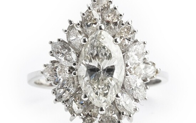 A diamond ring with a marquise-cut diamond weighing app. 1.29 ct. and marquise-cut diamonds weighing a total of app. 1.50 ct., mounted in 18k white gold.