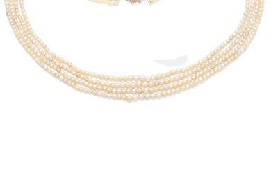 A natural pearl necklace with an emerald and diamond clasp