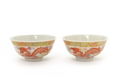 A pair of Chinese porcelain bowls decorated in colours with phoenix and dragon. Guangxu mark...