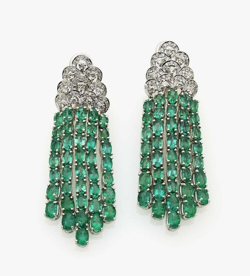A pair of earrings with brilliant cut diamonds and
