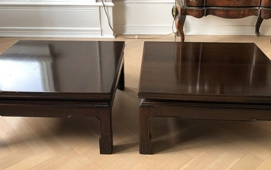 A pair of low square Chinese hardwood tables. Late 20th century. H. 26 cm. L. 55 cm. W. 55 cm. (2)