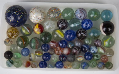 A selection of approximately sixty glass marbles, diameters ranging from 1.4cm to 4.4cm.
