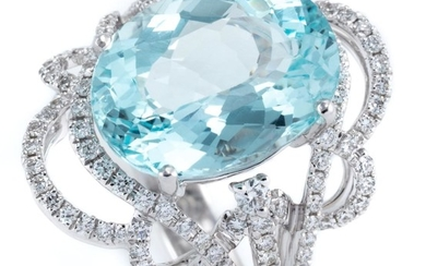 AN 18CT WHITE GOLD AQUAMARINE AND DIAMOND RING; featuring an oval cut aquamarine of approx. 6.63ct to scrolling pierced surround and...