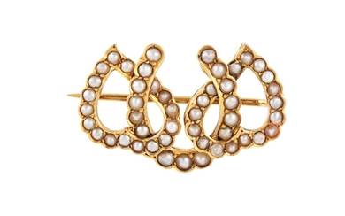 AN ANTIQUE TRIPLE HORSESHOE BROOCH, set with seed pearls, mo...