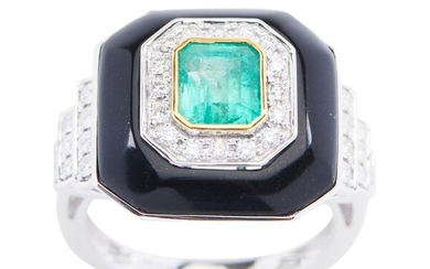AN EMERALD, ONXY AND DIAMOND RING