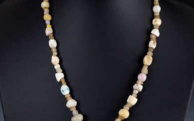 Ancient Roman Glass Necklace with glass and stone beads, serpentine amulet