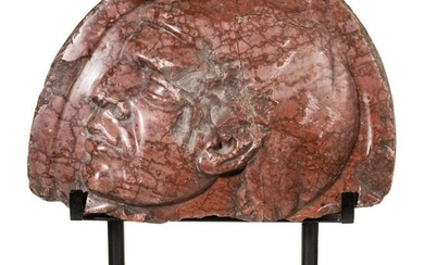 Benito Mussolini - a fragment of a red marble relief
