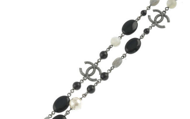 CHANEL - an imitation pearl and gem beaded necklace.