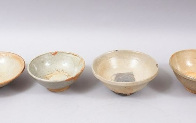 FOUR EARLY CHINESE POTTERY GLAZED BOWLS, some glazed