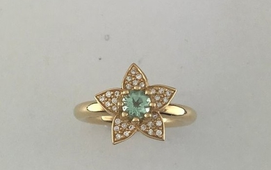 Flower ring in 750°/°° gold set with a...