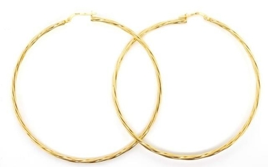 Large 9ct yellow gold hoop earrings with a fluted twist desi...