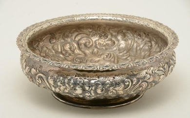 Large sterling silver repousse decorated footed bowl.