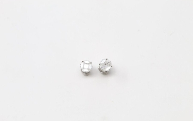 Pair of 18k (750) white gold ear studs with round and shuttle diamonds