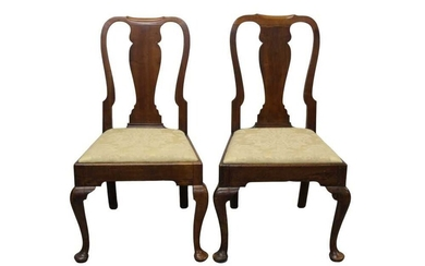 Pair of George I walnut side chairs, each with solid vase shaped splat on cabriole legs