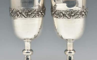 Pair of Sterling Silver Goblets with repousse band