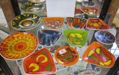 Seven Poole Pottery Dephis trapezoid dishes, and four circul...