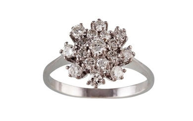 A DIAMOND CLUSTER RING, of approx. 0.75ct in total, mounted ...