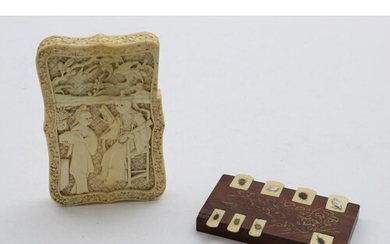 A 19TH CENTURY CHINESE CARVED IVORY CARD CASE with figures o...