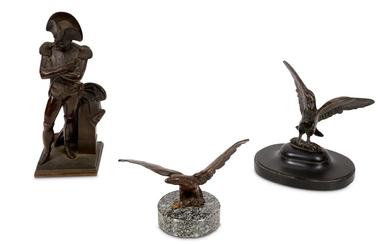 A 19TH CENTURY FRENCH BRONZE FIGURE OF NAPOLEON TOGETHER WITH TWO BRONZE MODELS OF EAGLES