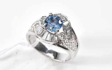 A BLUE SAPPHIRE AND DIAMOND DRESS RING IN 18CT WHITE GOLD, SIZE L