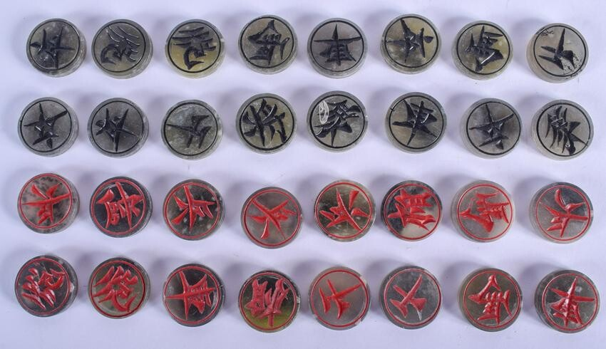 A COLLECTION OF CHINESE CARVED SOAPSTONE GAMING