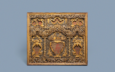 A Chinese carved and gilt wooden panel with red painted characters, 18/19th C.