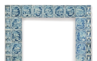 A FIRE SURROUND FORMED OF 18TH CENTURY GERMAN FAIENCE STOVE TILES