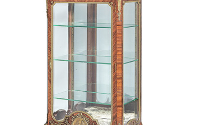 A French late 19th/early 20th century gilt bronze mounted kingwood vitrine attributed to Francois Linke (1855-1946)