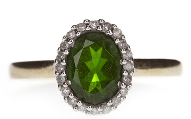 A GREEN GEM AND DIAMOND RING