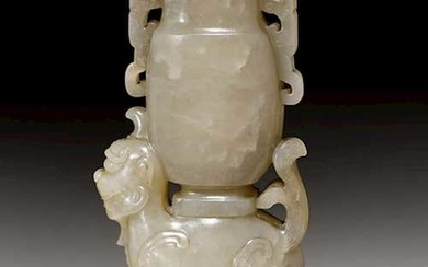 A GREYISH CELADON JADE CARVING OF A VASE ON A MYTHICAL BEAST.
