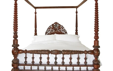 A LARGE CARVED MIXED WOOD FOUR POSTER BED, MID 19TH CENTURY