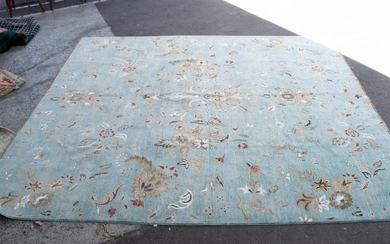 A LARGE PURE WOOL RUG IN TRADITIONAL FLORAL DESIGN IN A LIGHT BLUE FIELD