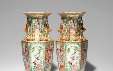 A PAIR OF CHINESE CANTON FAMILLE ROSE HEXAGONAL-SECTION VASES 19TH CENTURY Richly decorated in enamels and gilt to each facet with alternating panels of figural scenes and birds and insects amongst flowers, the shoulders and waisted necks applied with...