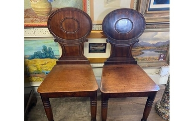 A PAIR OF EARLY 19TH CENTURY MAHOGANY HALL CHAIRS With oval ...