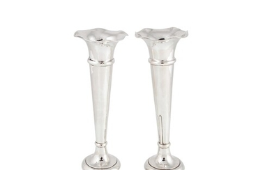 A PAIR OF GEORGE V SILVER TRUMPET VASES, with wavy rims of w...