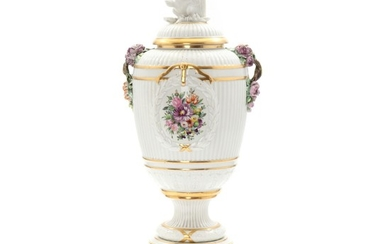 A Royal Copenhagen porcelain lid vase, decorated in colours and gold with flowers within cartouches. Juliane Marie mark. H. 70 cm.