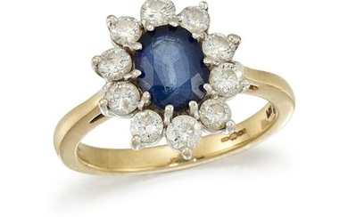 A SAPPHIRE AND DIAMOND CLUSTER RING The oval-cut