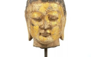A Tang style carved and parcel gilt...