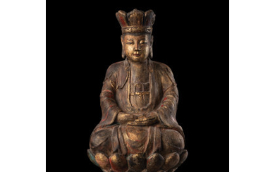 A carved wood seated Buddha, on stand (defects) China, Ming...