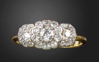 A diamond-set triple cluster ring, each old circular-cut diamond set within a surround of single-cut diamonds in gold, size L 1/2
