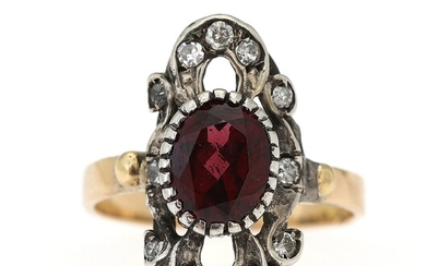 NOT SOLD. A garnet and diamond ring set with an oval-cut garnet encircled by diamonds,...